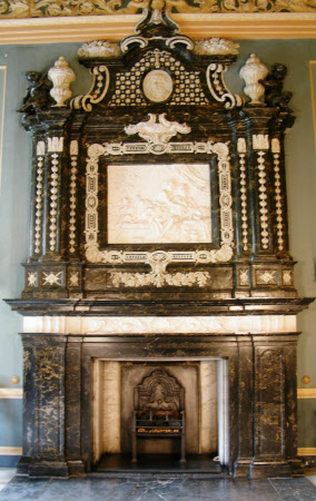 Marble fireplace with stucco overmantel.