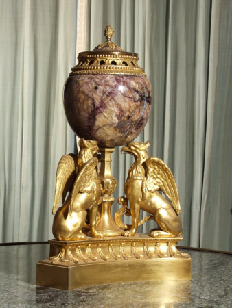 A blue-john oviform perfume burner and cover mounted in ormolu with pineapple finial, resting on ...