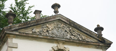 Roof pediment frieze of The Pin Mill. Shield with coat of arms showing a lion rampant surmounted by ...