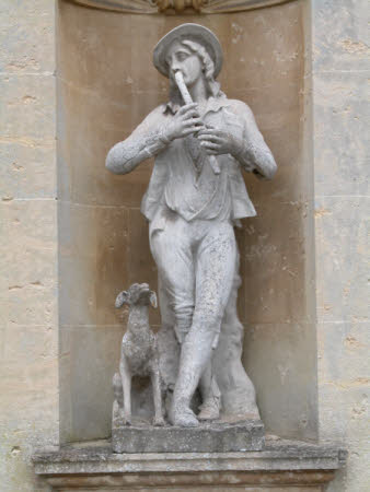 Male Figure with Pipe and a Dog