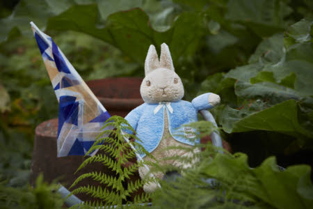 Peter Rabbit toy in the garden at Hill Top, near Sawrey, Cumbria.