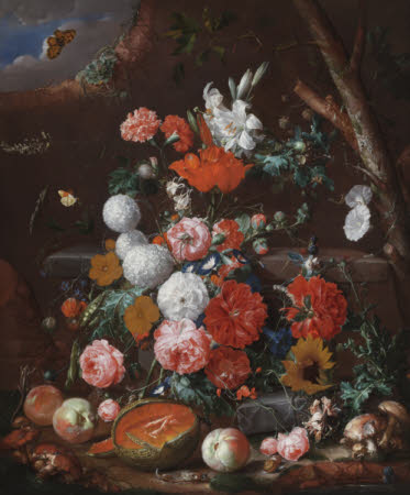 A Still Life of Flowers and Fruit arranged on a Stone Plinth in a Garden