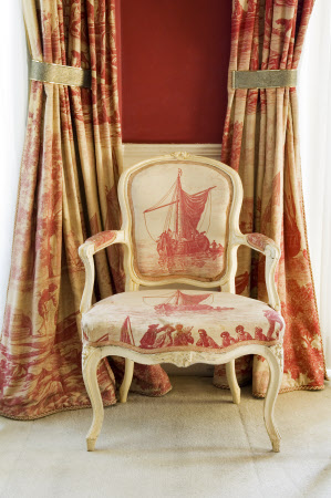 A Louis XV chair upholstered in toile de Jouy in the Octagon Room at Plas Newydd, on the Isle of Anglesey, Wales