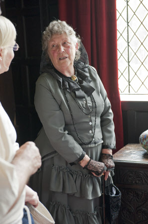 Volunteer in costume at Speke Hall, Liverpool.